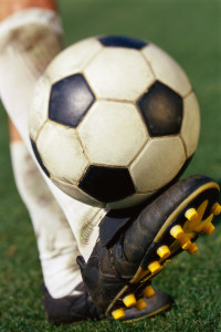 Soccer Player's Leg and Soccer Ball